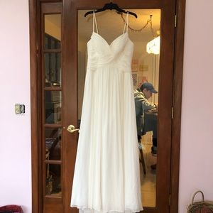 Beautiful wedding gown/dress with a slight train